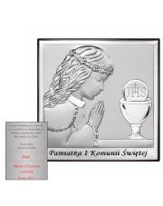 Obrazek modlącej się dziewczynki obok hostii