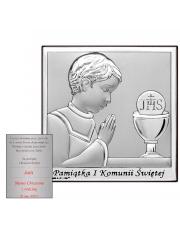 Obrazek modlącego się chłopca obok hostii